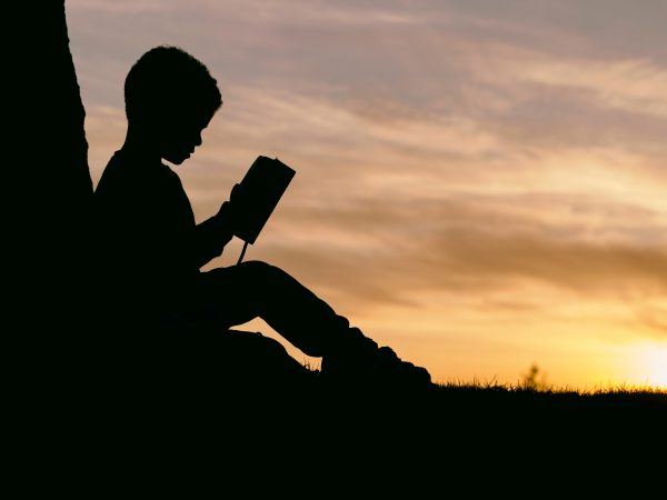 Picture child reading and sunset