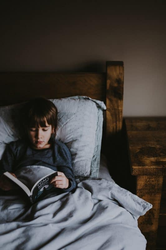 Picture boy reading in bed