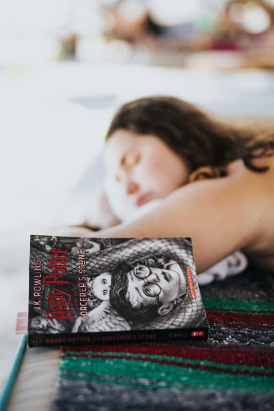 Picture girl sleeping and Harry Potter book