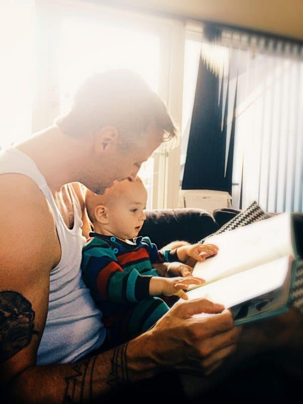 father and child reading