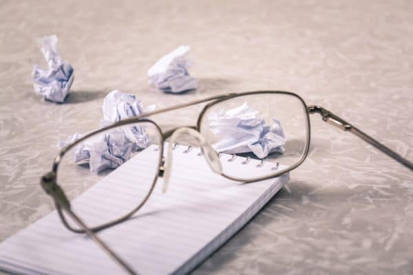 glasses and crumpled up paper