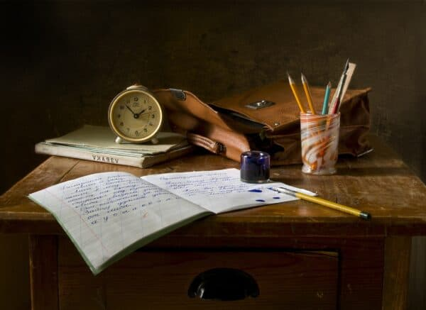 opened notebook on a wooden table